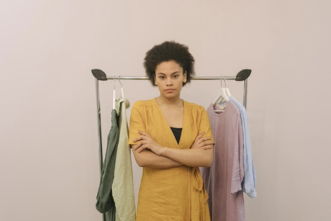 https://www.pexels.com/photo/woman-in-yellow-dress-standing-beside-clothes-rack-8484207/